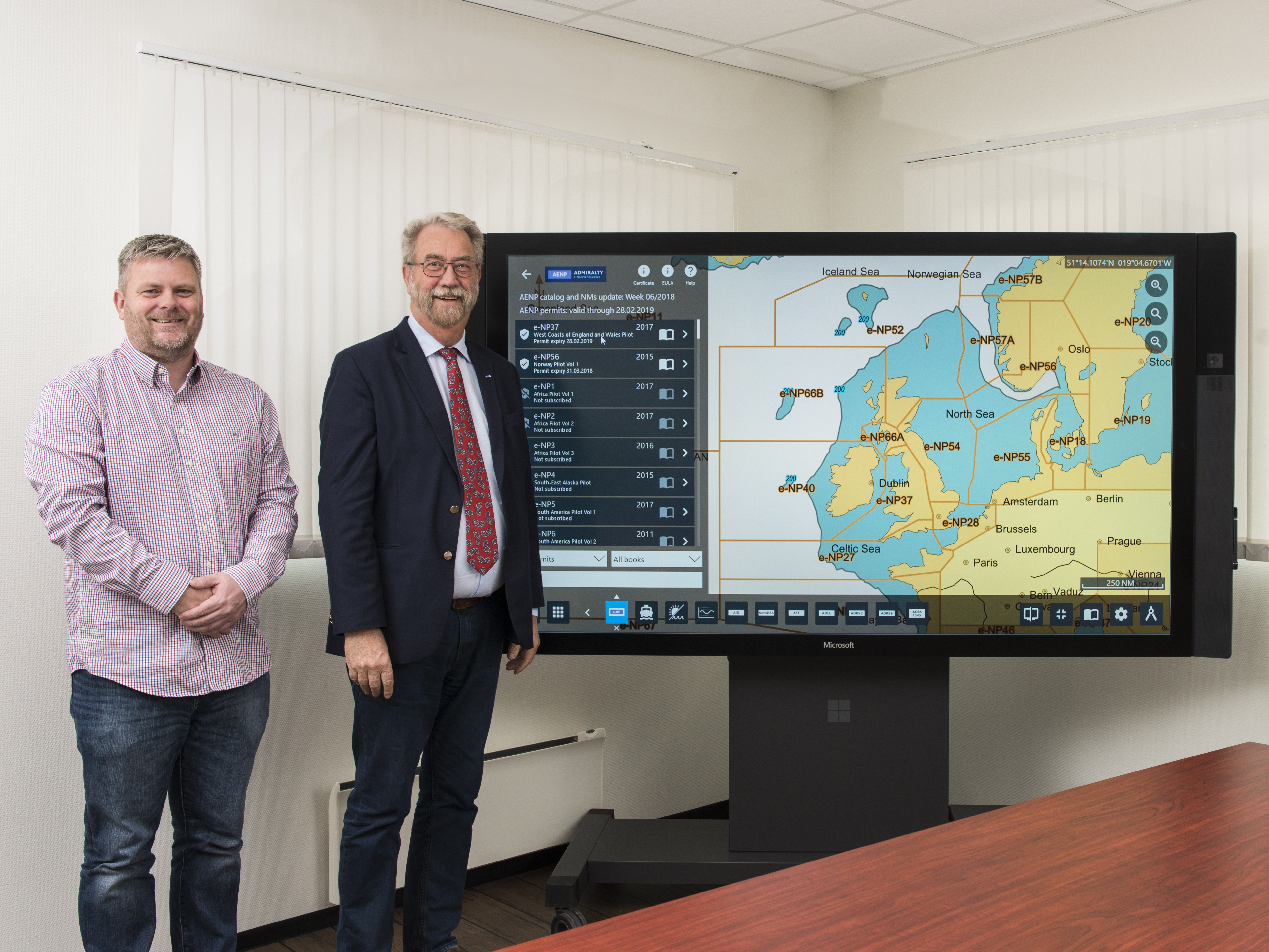 "NavStation 4.1 with AENP integration demonstrated on a big 84"" touchscreen monitor. NAVTOR Product Manager Gaute Fossmark and NAVTOR CEO Tor Svanes"